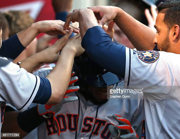 Jon Singleton of the Houston Astros celebrates with teammates in the dugout after Singleton's three run home run in the fourth inning against the Los...