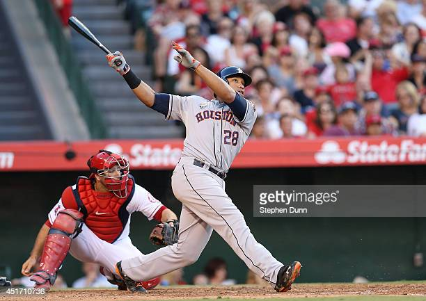 Jon Singleton of the Houston Astros hits a three run home run in the fourth inning against the Los Angeles Angels of Anaheim at Angel Stadium of...