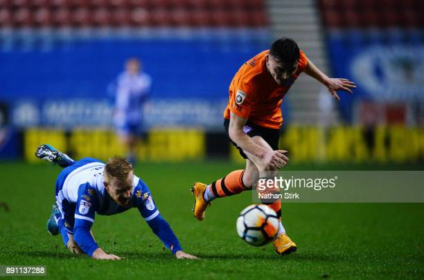 Jon Smith of AFC Fylde and David Perkins of Wigan Athletic in action during The Emirates FA Cup Second Round Replay match between Wigan Athletic and...