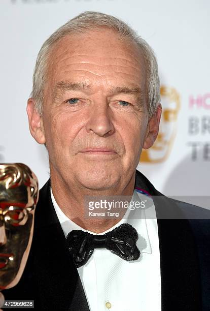 Jon Snow poses in the winners room at the House of Fraser British Academy Television Awards at Theatre Royal on May 10 2015 in London England
