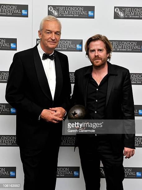 Jon Snow poses with Janus Metz winner of 'The Grierson Award' for documentary 'Armadillo' at the 54th BFI London Film Festival Awards at LSO St Lukes...