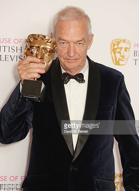 Jon Snow poses with the award for Best News Coverage for the Paris Massacre in the winners room at the House Of Fraser British Academy Television...