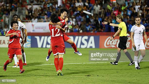 Jon So Yon of Korea DPR is congratulated on her goal during the FIFA U20 Women's World Cup Papua New Guinea 2016 Final between Korea DPR and France...