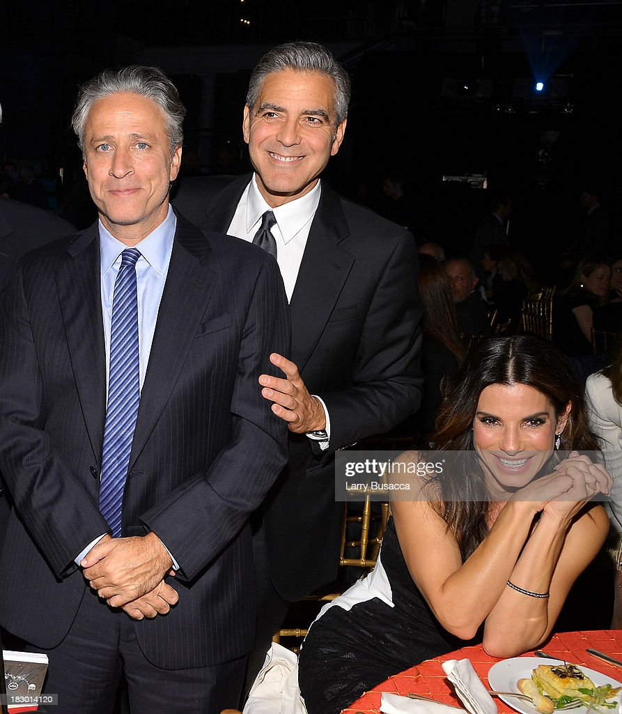 <a gi-track='captionPersonalityLinkClicked' href=/galleries/search?phrase=Jon+Stewart+-+Political+Satirist&family=editorial&specificpeople=202151 ng-click='$event.stopPropagation()'>Jon Stewart</a>, and actors <a gi-track='captionPersonalityLinkClicked' href=/galleries/search?phrase=George+Clooney&family=editorial&specificpeople=202529 ng-click='$event.stopPropagation()'>George Clooney</a> and <a gi-track='captionPersonalityLinkClicked' href=/galleries/search?phrase=Sandra+Bullock&family=editorial&specificpeople=202248 ng-click='$event.stopPropagation()'>Sandra Bullock</a> attend the USC Shoah Foundation Institute 2013 Ambassadors for Humanity gala at the American Museum of Natural History on October 3, 2013 in New York, New York.