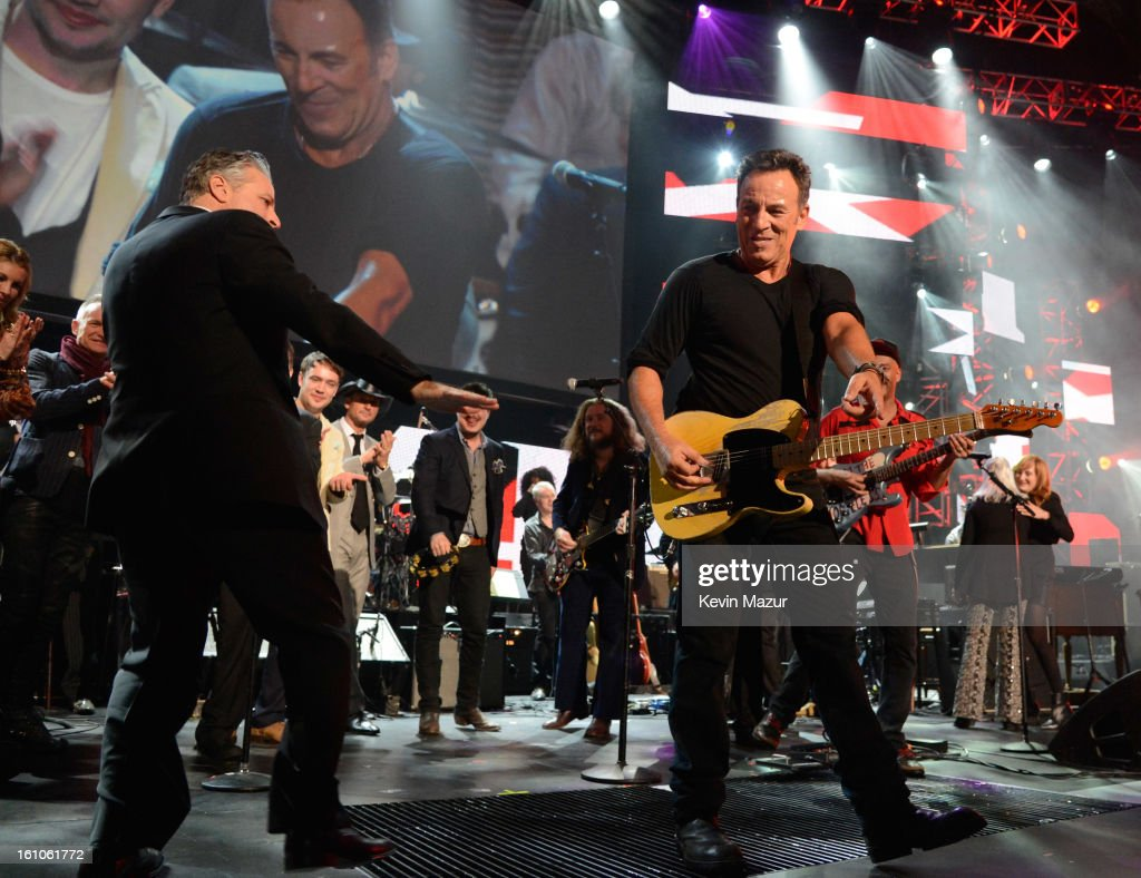 Jon Stewart and Bruce Springsteen perform onstage at MusiCares Person Of The Year Honoring Bruce Springsteen at Los Angeles Convention Center on February 8, 2013 in Los Angeles, California.