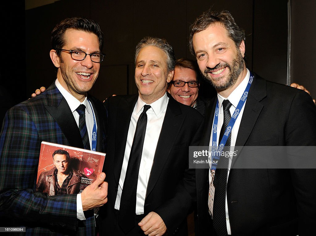 Jon Stewart and Judd Apatow attend MusiCares Person Of The Year Honoring Bruce Springsteen at Los Angeles Convention Center on February 8, 2013 in Los Angeles, California.