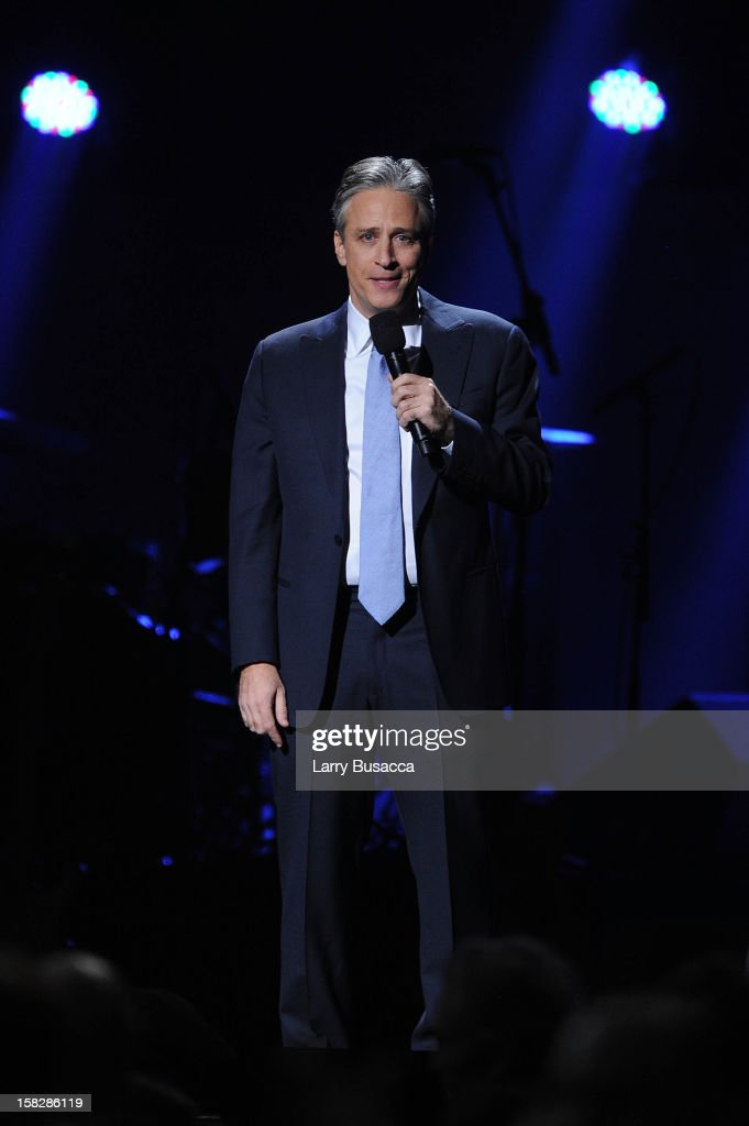 Jon Stewart performs at '12-12-12' a concert benefiting The Robin Hood Relief Fund to aid the victims of Hurricane Sandy presented by Clear Channel Media & Entertainment, The Madison Square Garden Company and The Weinstein Company at Madison Square Garden on December 12, 2012 in New York City.