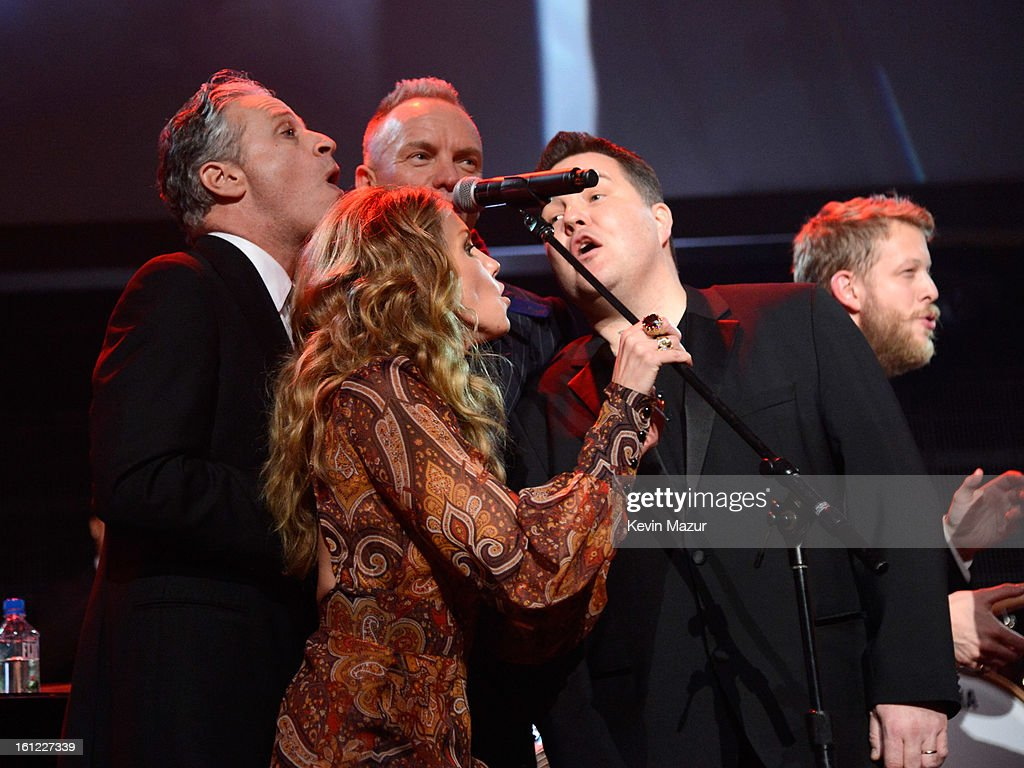 Jon Stewart, Sting and Faith Hill perform onstage at MusiCares Person Of The Year Honoring Bruce Springsteen at Los Angeles Convention Center on February 8, 2013 in Los Angeles, California.