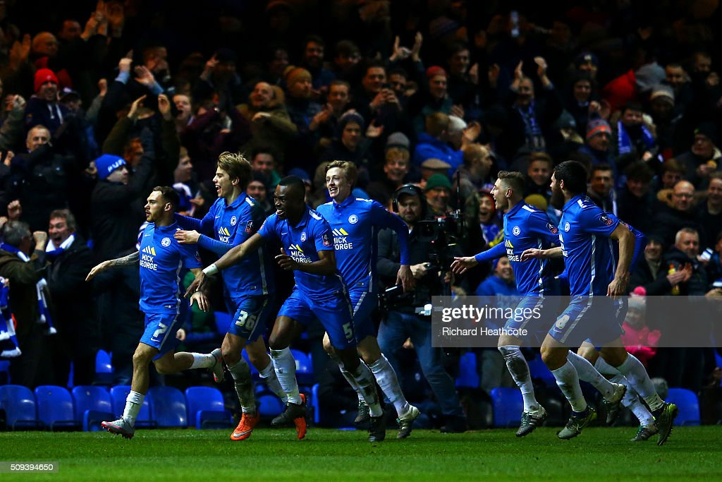 Jon Taylor (L) of Peterborough celebrates with team-mates after scoring the opening goal during the Emirates FA Cup fourth round replay match between Peterborough United and West Bromwich Albion at ABAX Stadium on February 10, 2016 in Peterborough, England.