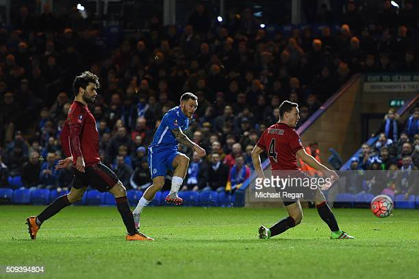 Jon Taylor of Peterborough scores the opening goal during the Emirates FA Cup fourth round replay match between Peterborough United and West Bromwich...