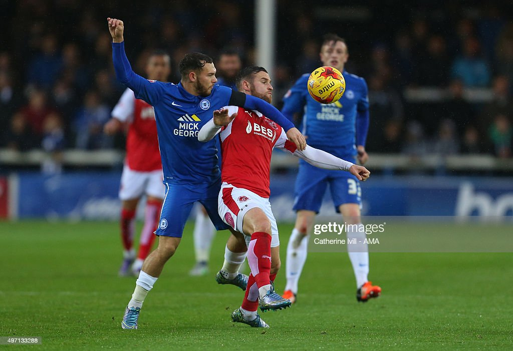 Jon Taylor of Peterborough United and Jimmy Ryan of Fleetwood Town during the Sky Bet League One match between Peterborough United and Fleetwood Town at London Road Stadium on November 14, 2015 in Peterborough, England.
