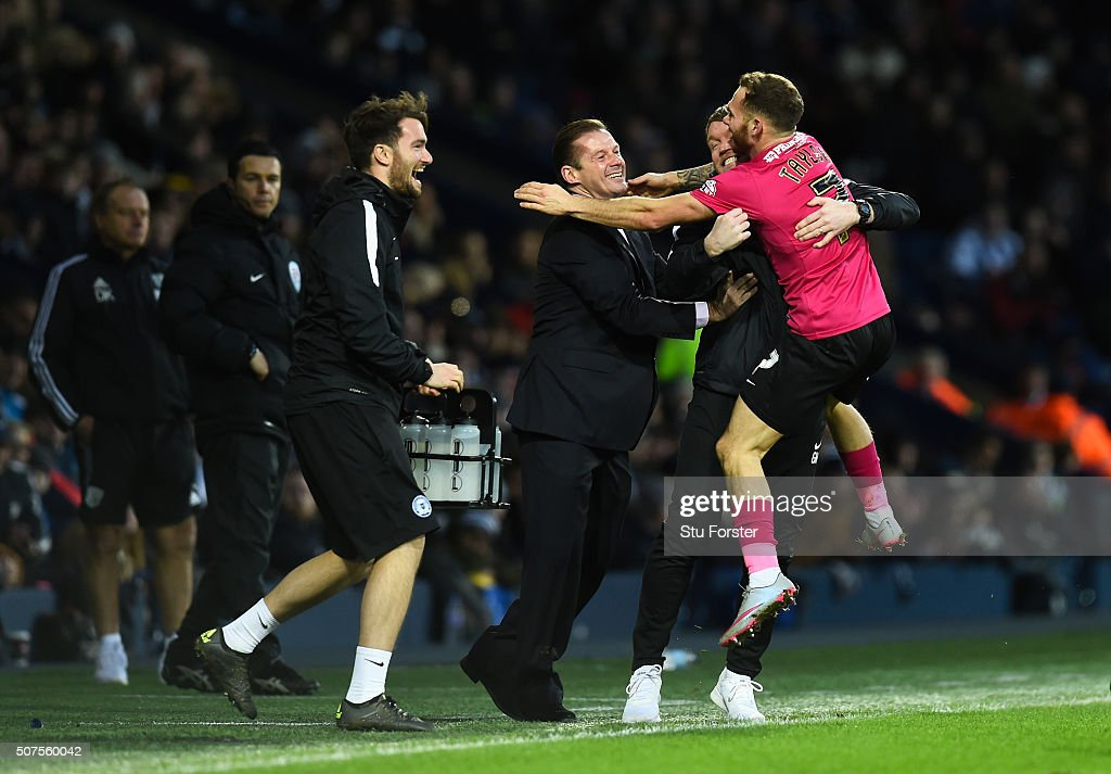 Jon Taylor (1st R) of Peterborough United celebrates scoring his team's second goal with manager Graham Westley (3rd R) and staffs during the Emirates FA Cup Fourth Round match between West Bromwich Albion and Peterborough United at The Hawthorns on January 30, 2016 in West Bromwich, England.