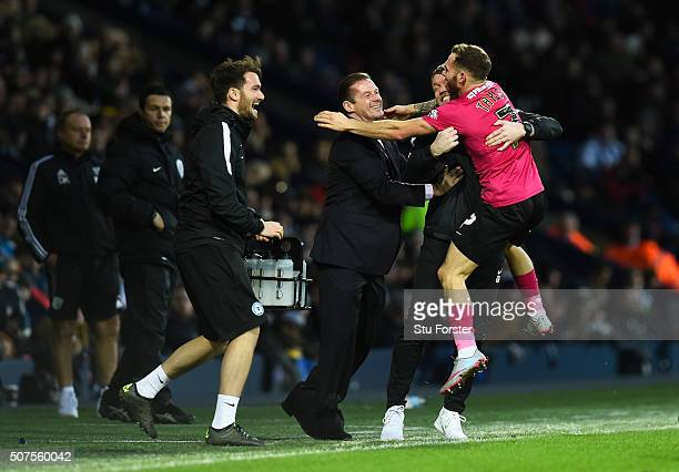Jon Taylor of Peterborough United celebrates scoring his team's second goal with manager Graham Westley and staffs during the Emirates FA Cup Fourth...
