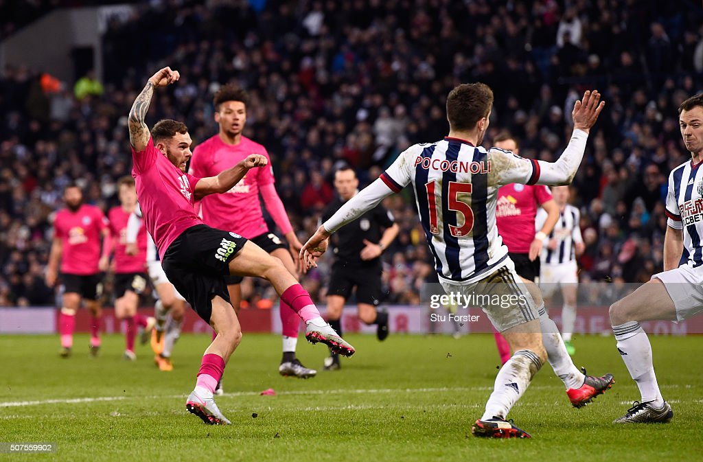 Jon Taylor (1st L) of Peterborough United scores his team's second goal during the Emirates FA Cup Fourth Round match between West Bromwich Albion and Peterborough United at The Hawthorns on January 30, 2016 in West Bromwich, England.