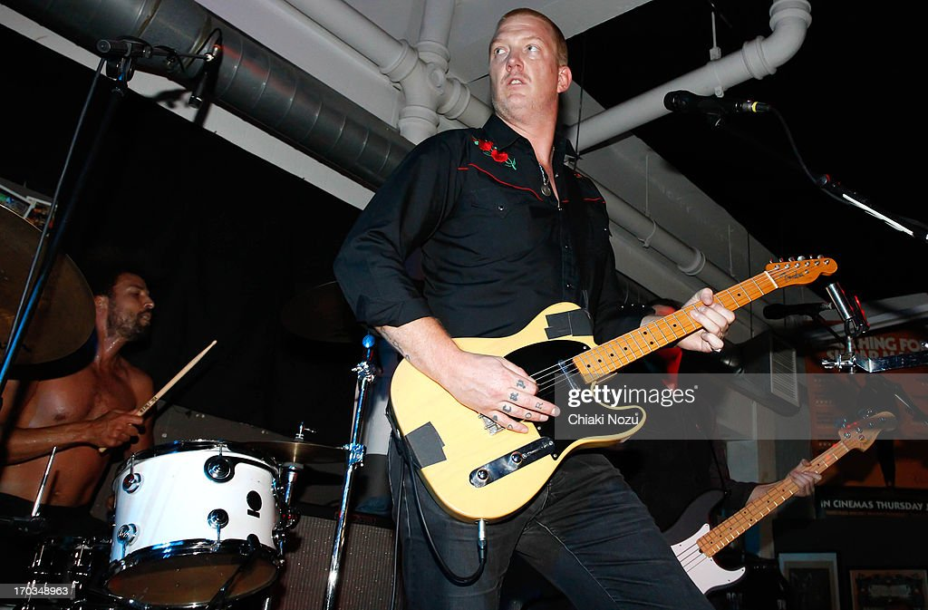 Jon Theodore and <a gi-track='captionPersonalityLinkClicked' href=/galleries/search?phrase=Josh+Homme&family=editorial&specificpeople=211243 ng-click='$event.stopPropagation()'>Josh Homme</a> of Queens of the Stone Age perform at Rough Trade East on June 11, 2013 in London, England.
