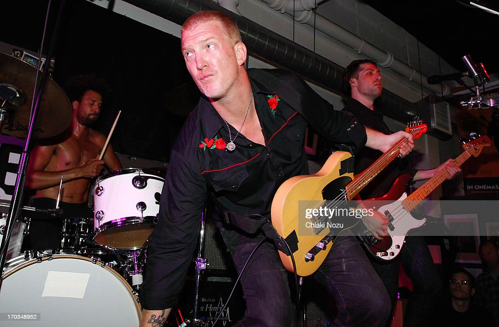 Jon Theodore, <a gi-track='captionPersonalityLinkClicked' href=/galleries/search?phrase=Josh+Homme&family=editorial&specificpeople=211243 ng-click='$event.stopPropagation()'>Josh Homme</a> and Michael Shuman of Queens of the Stone Age perform at Rough Trade East on June 11, 2013 in London, England.
