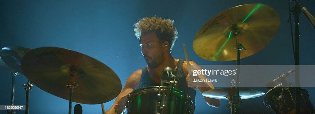 Jon Theodore of Queens of the Stone Age performs at Nashville Municipal Auditorium on October 7, 2013 in Nashville, Tennessee.