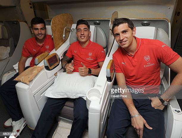 Jon Toral Hector Bellerin and Emiliano Martinez of Arsenal on the Emirates plane at Stansted Airport on July 12 2015 in London England