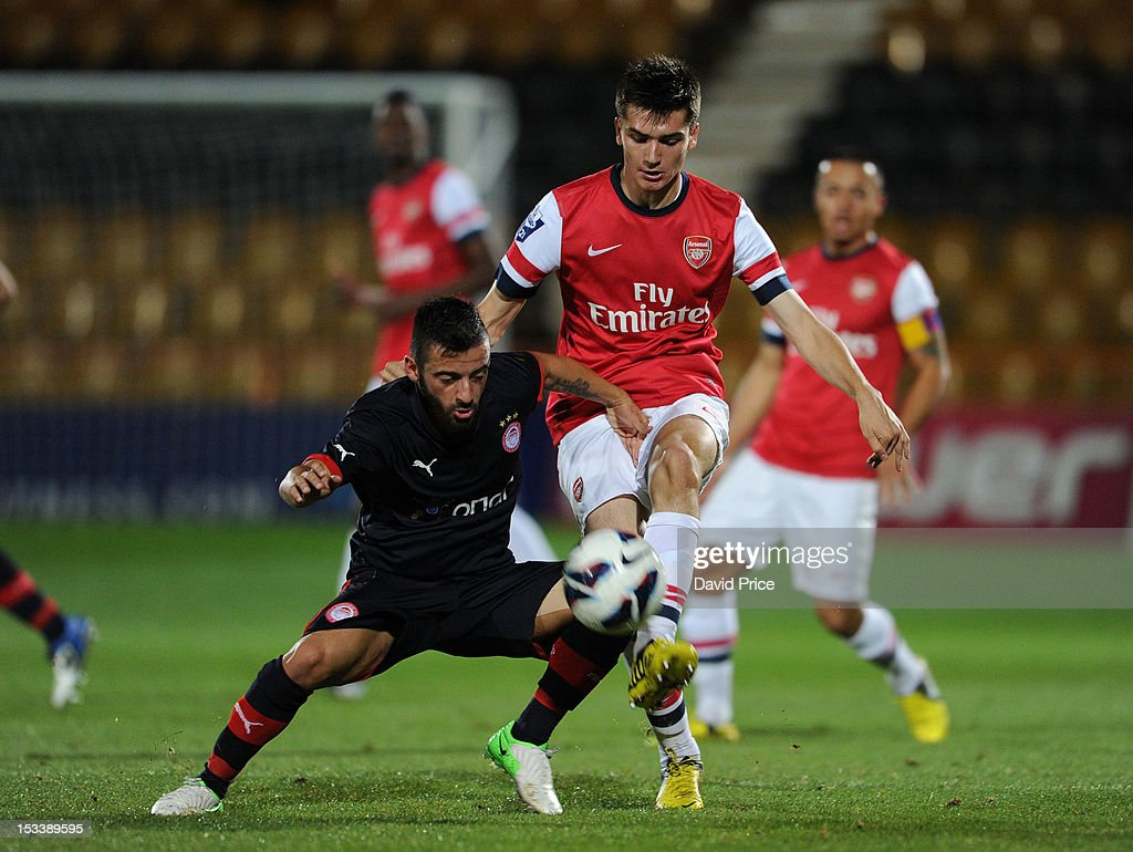Jon Toral of Arsenal is challenged by Emmanouil Siopos of Olympiacos during the NextGen Series match between Arsenal U19 and Olympiacos U19 at Underhill Stadium on October 4, 2012 in Barnet, United Kingdom.