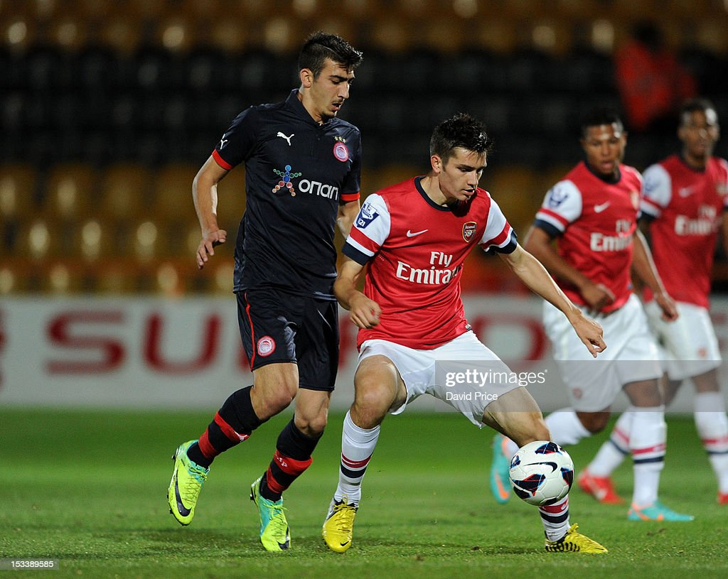Jon Toral of Arsenal is closed down by Nikos Ioannidis of Olympiacos during the NextGen Series match between Arsenal U19 and Olympiacos U19 at Underhill Stadium on October 4, 2012 in Barnet, United Kingdom.
