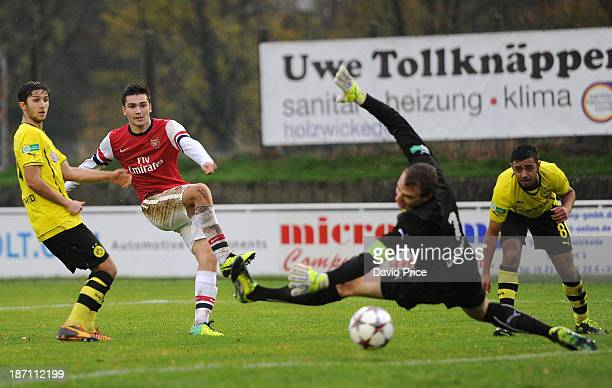 Jon Toral scores Arsenal's 2nd goal past Steffen Goecke of Dortmund during the match between Borussia Dortmund U19 and Arsenal U19 in the UEFA Youth...