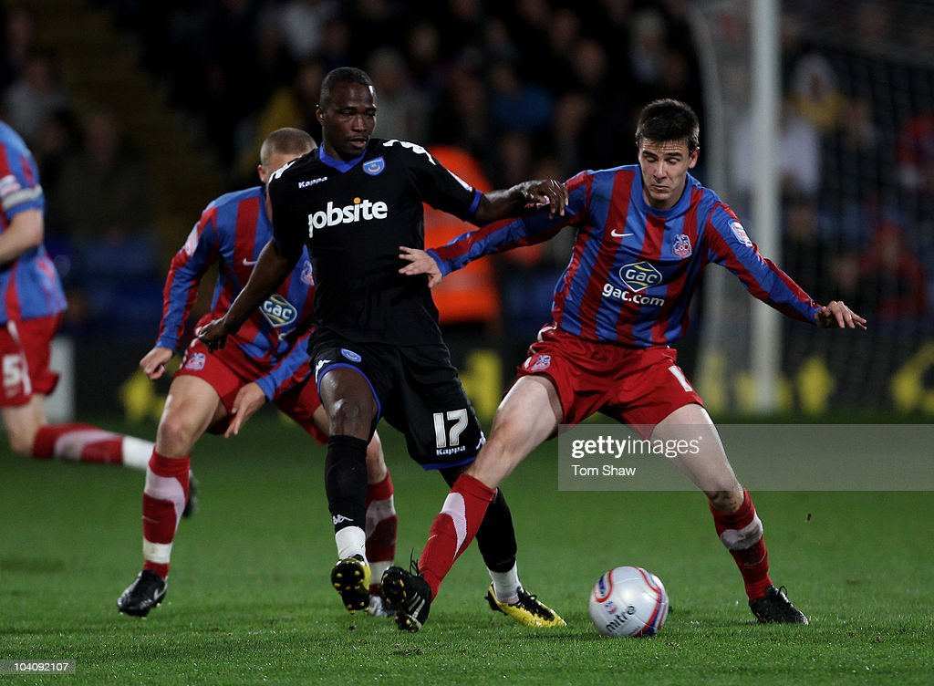 Jon Utaka of Portsmouth tussles with Andrew Dorman of Palace during the npower Championship match between Crystal Palace and Portsmouth at Selhurst Park on September 14, 2010 in London, England.