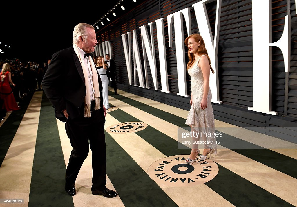 Jon Voight (L) and Jessica Chastain attend the 2015 Vanity Fair Oscar Party hosted by Graydon Carter at the Wallis Annenberg Center for the Performing Arts on February 22, 2015 in Beverly Hills, California.