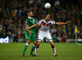 Jon Walters of Republic of Ireland and Matthias Ginter of Germany compete for the ball during the UEFA EURO 2016 Qualifier group D match between...