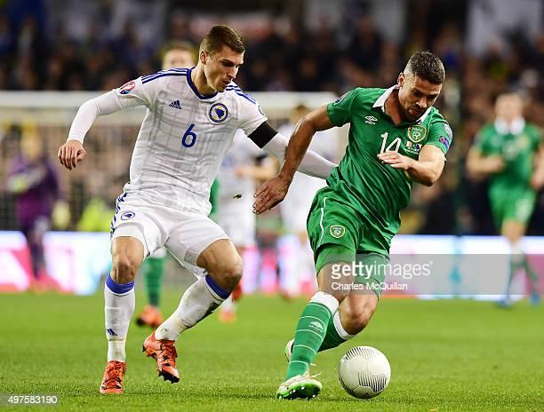 Jon Walters of Republic of Ireland and Ognjen Vranges of BosniaHerzegovina during the Euro 2016 playoff second leg match at Aviva Stadium on November...