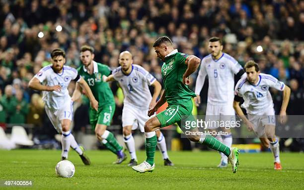 Jon Walters of Republic of Ireland scores from the penalty spot during the Euro 2016 playoff second leg match between the Republic of Ireland and...