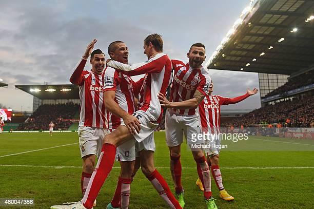 Jon Walters of Stoke is mobed by Phil Bardsley and Peter Crouch after scoring to make it 30 during the Barclays Premier League match between Stoke...