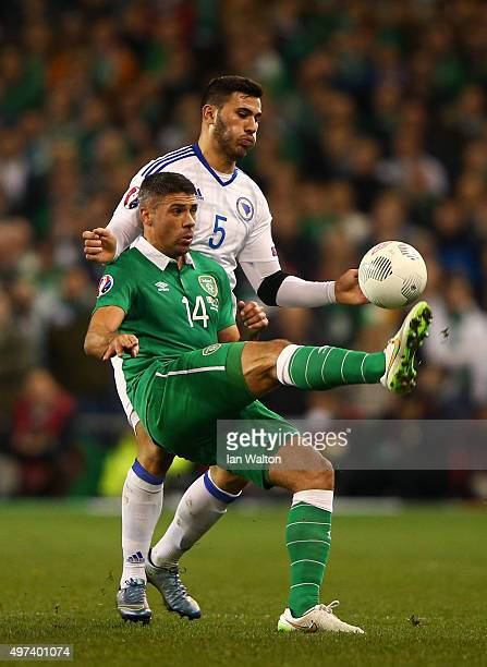 Jon Walters of the Republic of Ireland controls the ball under pressure from Sead Kolasinac of Bosnia and Herzegovina during the UEFA EURO 2016...