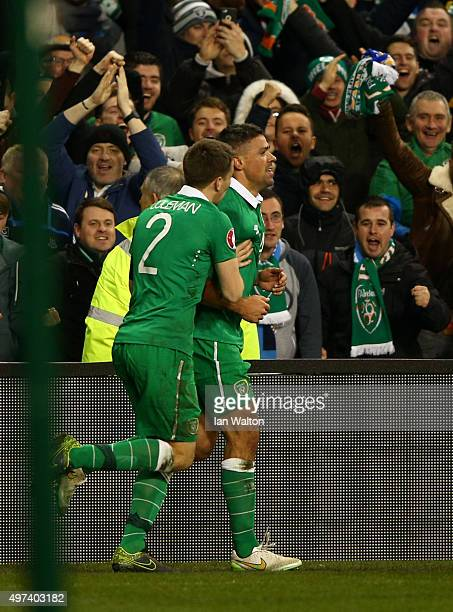Jon Walters of the Republic of Ireland is congratulated by teammate Seamus Coleman of the Republic of Ireland after scoring his team's second goal...
