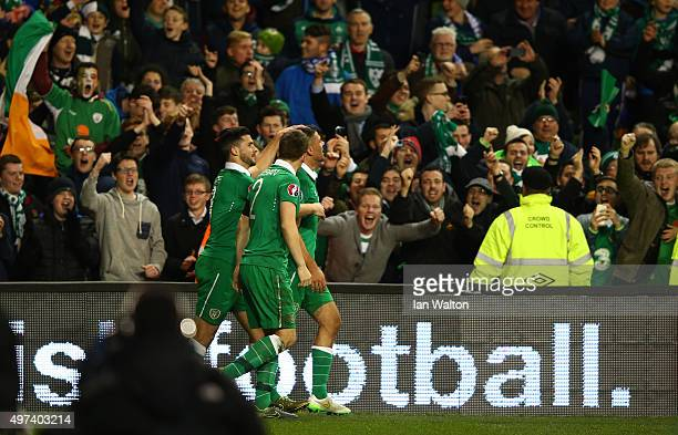 Jon Walters of the Republic of Ireland is congratulated by teammates after scoring his team's second goal during the UEFA EURO 2016 Qualifier play...