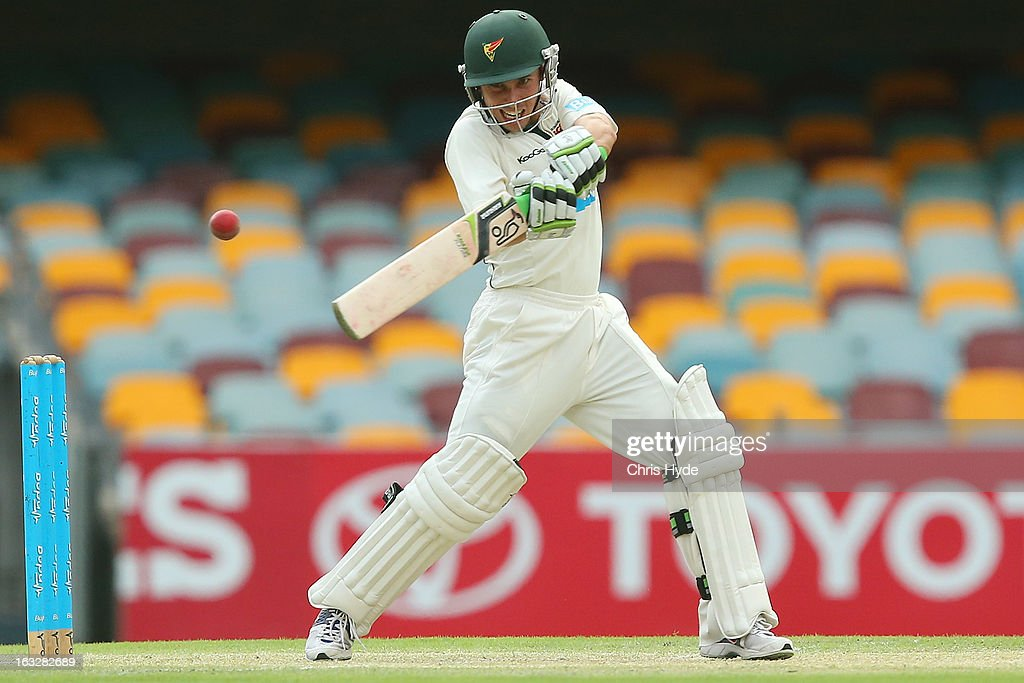 Jon Wells of the Tigers bats during day one of the Sheffield Shield match between the Queensland Bulls and the Tasmanian Tigers at The Gabba on March 7, 2013 in Brisbane, Australia.
