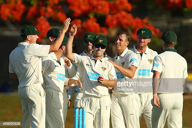 Jon Wells of the Tigers celebrates with team mates after taking a catch to dismiss Marnus Labuschagne of the Bulls during day one of the Sheffield...
