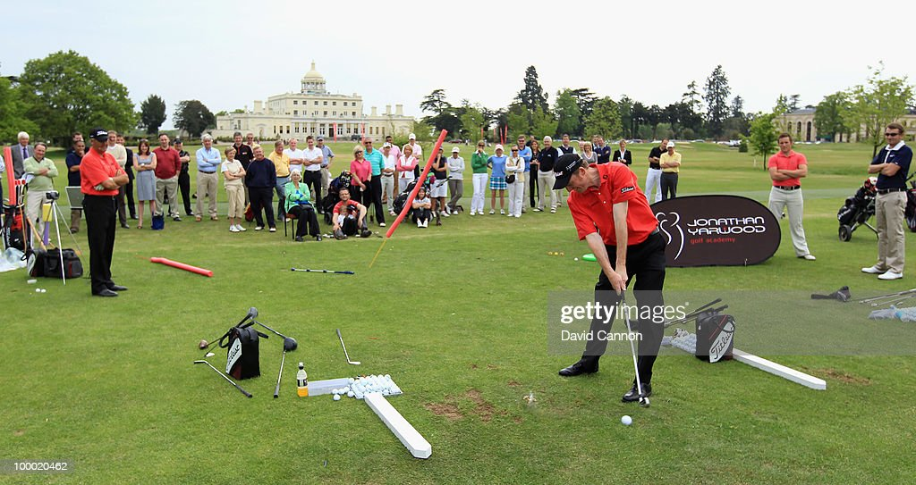 Jon Yarwood watches as one of his team performs a trick shot with a watch during the launch of the Jon Yarwood Golf Academy at Stoke Park, on May 19, 2010, in Slough, England.