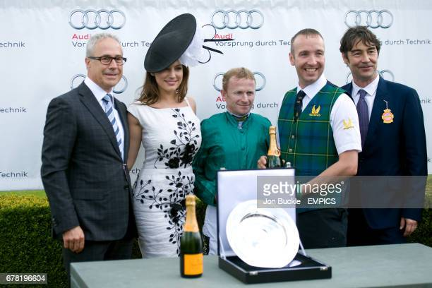 Jon Zammett Kelly Brook and Nat Parker present Jockey Joe Fanning with his award after Heavy Metal won the Audi Richmond Stakes