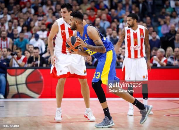 Jonah Bolden of Maccabi in action against Milko Bjelica of Crvena Zvezda during the 2017/2018 Turkish Airlines EuroLeague Regular Season game between...