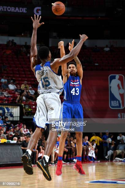 Jonah Bolden of the Philadelphia 76ers shoots the ball against Damian Jones of the Golden State Warriors during the 2017 Las Vegas Summer League on...