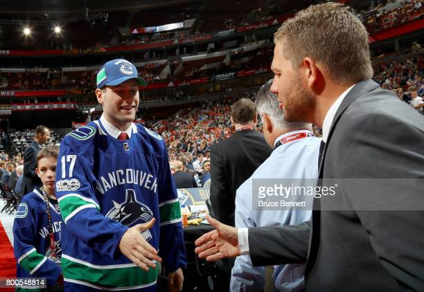 Jonah Gadjovich meets with executives after being selected 55th overall by the Vancouver Canucks during the 2017 NHL Draft at the United Center on...