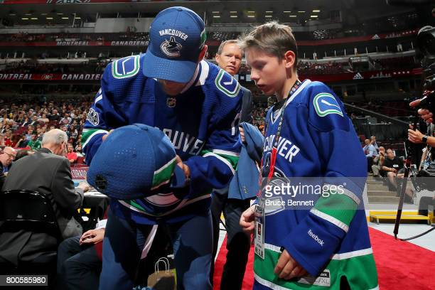 Jonah Gadjovich signs an autograph after being selected 55th overall by the Vancouver Canucks during the 2017 NHL Draft at the United Center on June...