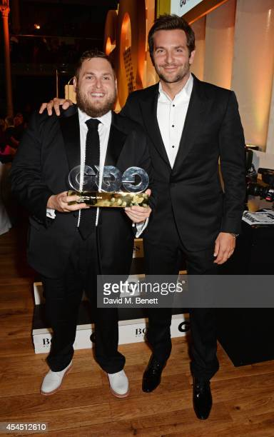 Jonah Hill winner of the International Male award and presenter Bradley Cooper attend the GQ Men Of The Year awards in association with Hugo Boss at...