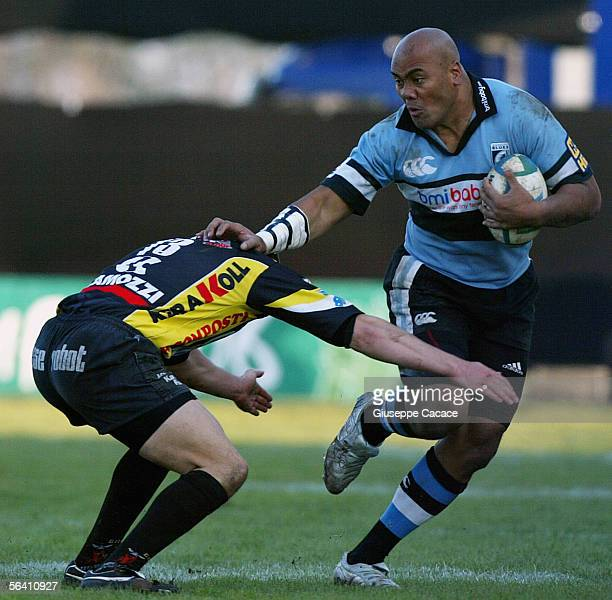 Jonah Lomu of Cardiff hands off Calvisano's Emiliano Mulieri during the Heineken European Cup match between Calvisano and Cardiff Blues at the San...
