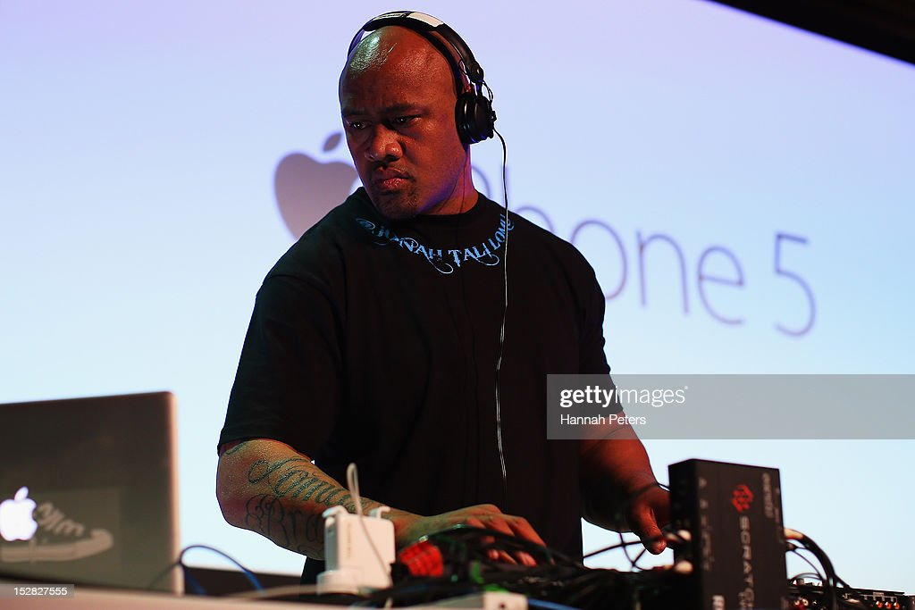 Jonah Lomu plays tunes during the launch of the new iPhone 5 on September 27, 2012 in Auckland, New Zealand. Telecom, with help of rugby great Jonah Lomu, launched the much-anticipated Apple iPhone 5 last night in Auckland. Jonah was joined by Opshop frontman and New Zealand's Got Talent judge, Jason Kerrison in Wellington via live feed between the two cities. Auckland, Wellington and Christchurch stores opened their doors at 12.01am to eager customers, some waiting since 8am the previous morning. Customers were offered a 'luxury' cueing experience at the Victoria Street West store, with the iPhone officially available for sale at 12:01am.