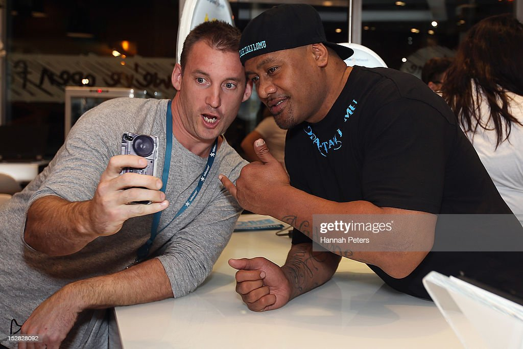 Jonah Lomu poses with a customer during the launch of the new iPhone 5 on September 27, 2012 in Auckland, New Zealand. Telecom, with help of rugby great Jonah Lomu, launched the much-anticipated Apple iPhone 5 last night in Auckland. Jonah was joined by Opshop frontman and New Zealand's Got Talent judge, Jason Kerrison in Wellington via live feed between the two cities. Auckland, Wellington and Christchurch stores opened their doors at 12.01am to eager customers, some waiting since 8am the previous morning. Customers were offered a 'luxury' cueing experience at the Victoria Street West store, with the iPhone officially available for sale at 12:01am.