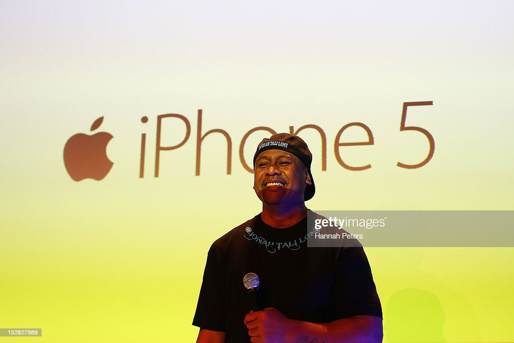 Jonah Lomu speaks during the launch of the new iPhone 5 on September 27, 2012 in Auckland, New Zealand. Telecom, with help of rugby great Jonah Lomu, launched the much-anticipated Apple iPhone 5 last night in Auckland. Jonah was joined by Opshop frontman and New Zealand's Got Talent judge, Jason Kerrison in Wellington via live feed between the two cities. Auckland, Wellington and Christchurch stores opened their doors at 12.01am to eager customers, some waiting since 8am the previous morning. Customers were offered a 'luxury' cueing experience at the Victoria Street West store, with the iPhone officially available for sale at 12:01am.
