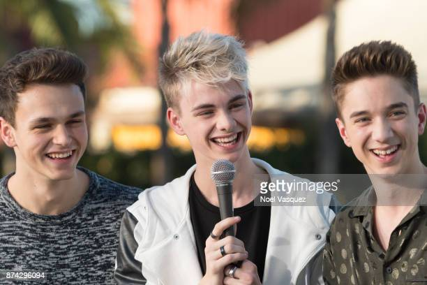 Jonah Marais Corbyn Besson and Daniel Seavey of Why Don't We visit 'Extra' at Universal Studios Hollywood on November 14 2017 in Universal City...