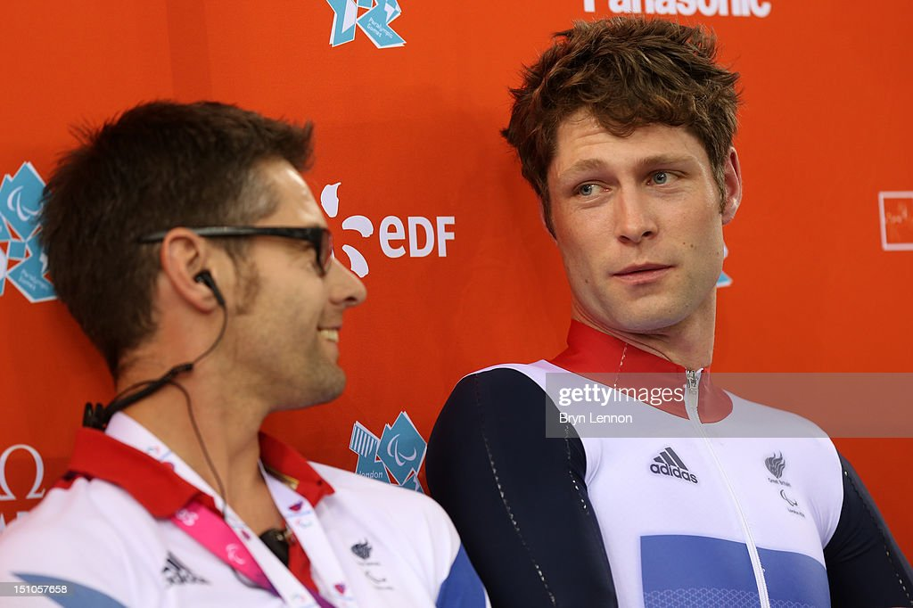 JonAllan Butterworth of Great Britain and coach Chris Furber speak following the Men's Individual C45 1km Cycling Time Trial final on day 2 of the...