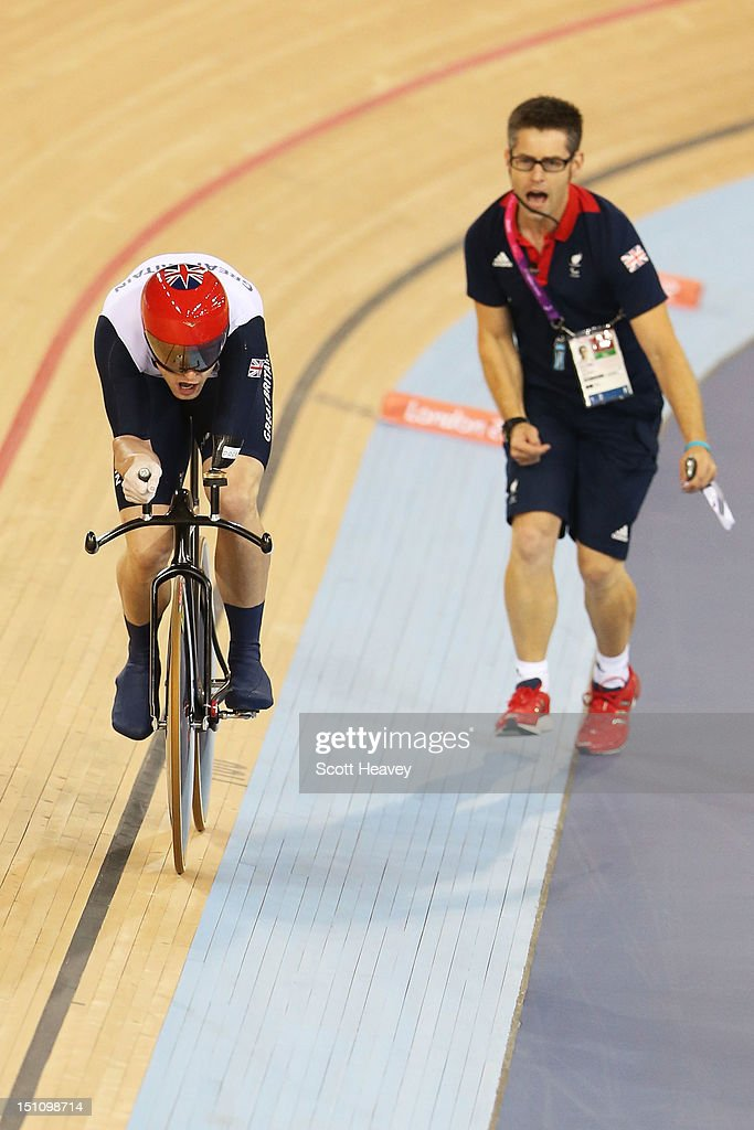 JonAllan Butterworth of Great Britain is urged on by coach Chris Furber in the Men's Individual C5 Pursuit Cycling qualification on day 3 of the...